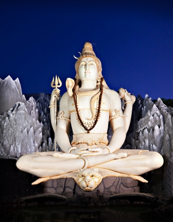 BANGALORE, INDIA - MARCH 27: Big Lord Shiva statue sitting in lotus with trident on March 27, 2012 in Bangalore, India. This Shiva Statue is highest in the world - 65 feet high. Stock Photo - 22100911