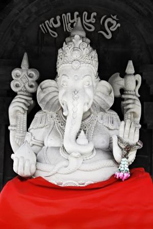 BALI, INDONESIA - FEBRUARY 26: White Ganesha statue at Ulun Danu temple on February, 26, 2011, Bali, Indonesia. Ganesha is a most powerful hindu god.  Stock Photo - 22100948