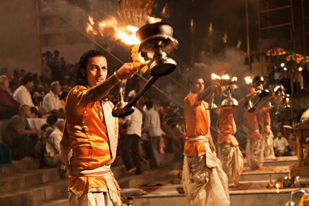 ritual: VARANASI, INDIA - APRIL 11: An unidentified Hindu priest performs religious Ganga Aarti ritual (fire puja) at Dashashwamedh Ghat on April 11, 2012 in Varanasi, Uttar Pradesh, India Editorial