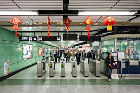 HONG KONG - FEBRUARY 22: Subway station interior on FEBRUARY 22, 2012 in Hong Kong. Over 90% daily travelers use public transport. Its the highest rank in the world.