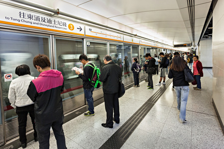 HONG KONG - FEBRUARY 23: Subway station interior on February 23, 2013 in Hong Kong. Over 90% daily travelers use public transport. Its the highest rank in the world.