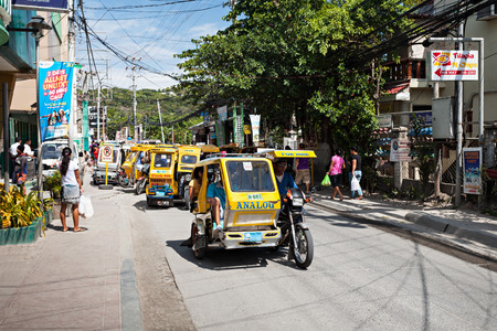 BORACAY, PHILIPPINES - MARCH 04: Tricycle on the street, March 04, 2013, Boracay, Philippines. Motorized tricycles are a common means of passenger transport everywhere in the Philippines.
