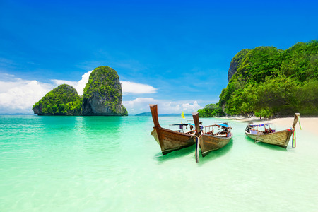 Beauty beach and limestone rocks, focus on the boats Stock Photo