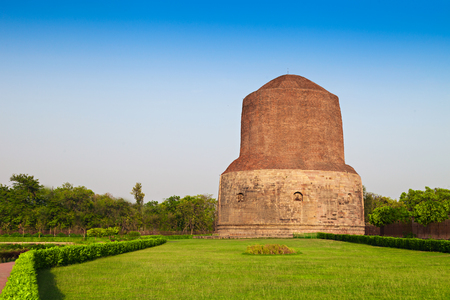 vihar: Dhamekh Stupa on green grass in Sarnath, India