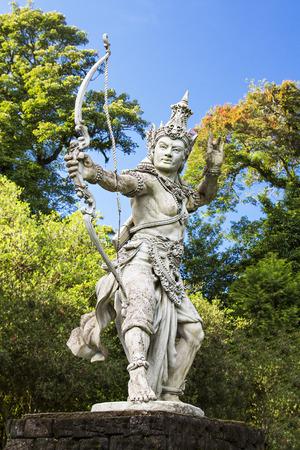 Sculpture of archer Arjuna in Bali botanic garden
