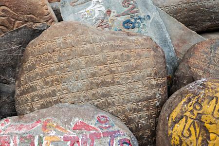 Om mani padme hum stones near tibetan monastery Stock Photo