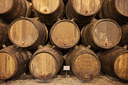 portuguese: Barrels in the wine cellar, Porto, Portugal