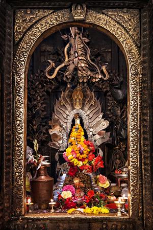 KATMANDU, NEPAL - APRIL 16: Golden altar in hindu temple at Durbar aquare on April 16, 2012, Katmandu, Nepal.