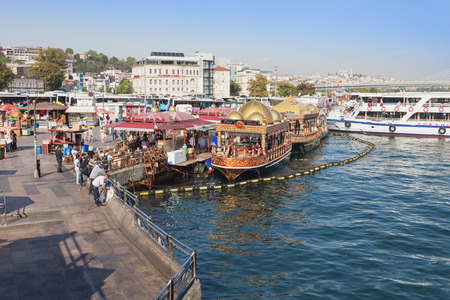eminonu: ISTANBUL, TURKEY - SEPTEMBER 09, 2014: Traditional floating fish restaurants at the Eminonu pier on September 09, 2014 in Istanbul, Turkey.