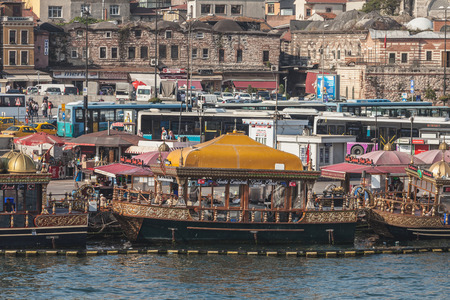 eminonu: ISTANBUL, TURKEY - SEPTEMBER 09, 2014: Traditional floating fish restaurants at the Eminonu pier on September 09, 2014 in Istanbul, Turkey.