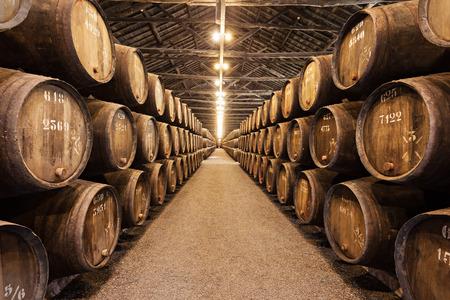 douro: PORTO, PORTUGAL - JULY 01: Barrels with Porto Wine in the wine cellar on July 01, 2014 in Porto, Portugal