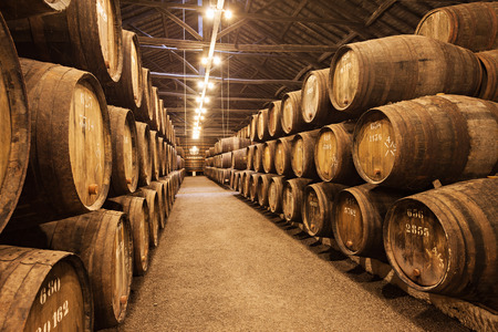 PORTO, PORTUGAL - JULY 01: Barrels with Porto Wine in the wine cellar on July 01, 2014 in Porto, Portugal