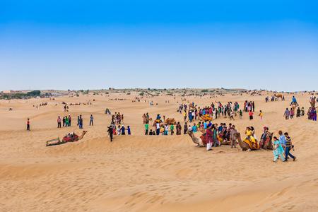 jaisalmer: JAISALMER, INDIA - OCTOBER 13: Unidenfified people and camels in Thar desert on October 13, 2013, Jaisalmer, India. Editorial
