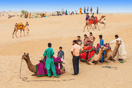 thar: JAISALMER, INDIA - OCTOBER 13: Unidenfified people and camels in Thar desert on October 13, 2013, Jaisalmer, India. Editorial