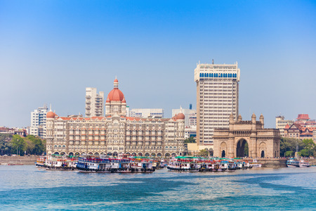 febuary: MUMBAI, INDIA - FEBRUARY 21: The Taj Mahal Palace Hotel and Gateway of India on Febuary 21, 2014 in Mumbai, India.
