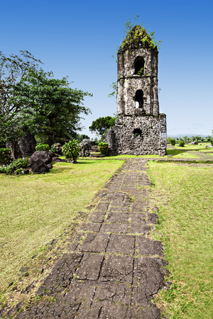 Cagsawa Ruins are the remnants of an 18th century Franciscan church, built in 1724 and destroyed by the 1814 eruption of the Mayon Volcano. Stock Photo