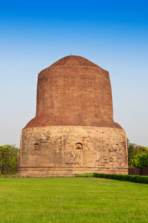 Dhamekh Stupa on green grass in Sarnath, India