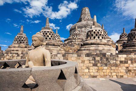 stupas: Buddha statue in Borobudur Temple, Java island, Indonesia.