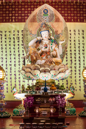 relic: SINGAPORE - OCTOBER 16, 2014: Buddha Tooth Relic Temple interior. Its a main Buddhist temple in the Chinatown district of Singapore. Editorial