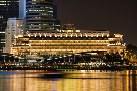 lofty: SINGAPORE - OCTOBER 16, 2014: The Fullerton Hotel Singapore is a five star luxury hotel located near the mouth of the Singapore River, in the  Downtown Core of Central Area, Singapore. Editorial