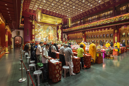 buddhist temple: SINGAPORE - OCTOBER 16, 2014: Buddha Tooth Relic Temple interior. Its a main Buddhist temple in the Chinatown district of Singapore. Editorial