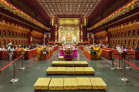 chinese pagoda: SINGAPORE - OCTOBER 16, 2014: Inside the Buddha Tooth Relic Temple. It is a Buddhist temple located in the Chinatown district of Singapore.