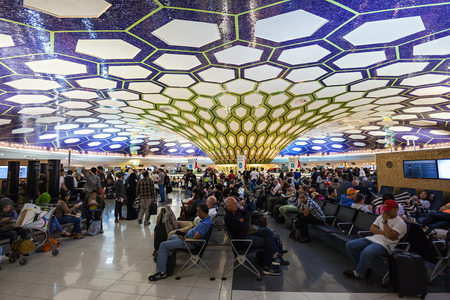terminals: ABU DHABI, UAE - OCTOBER 14, 2014: Abu Dhabi International Airport interior.