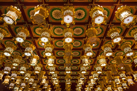 buddhist temple: SINGAPORE - OCTOBER 16, 2014: Inside the Buddha Tooth Relic Temple. It is a Buddhist temple located in the Chinatown district of Singapore.