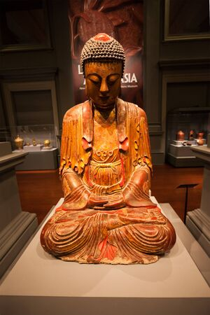 civilisations: SINGAPORE - OCTOBER 15, 2014: Buddha statue in Asian Civilisations Museum.