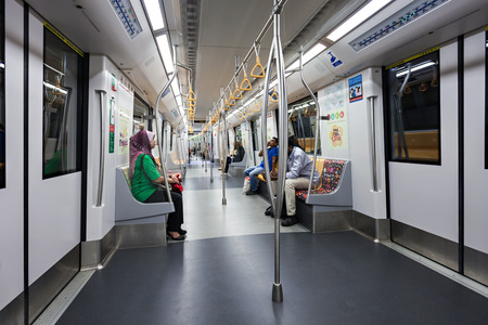 transit: SINGAPORE - OCTOBER 18, 2014: The Mass Rapid Transit is a rapid transit system forming the major component of the railway system in Singapore.