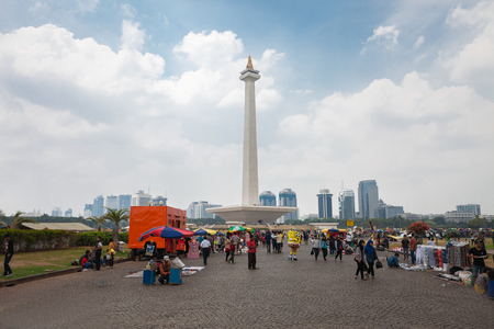 indonesia: JAKARTA, INDONESIA - OCTOBER 19, 2014: The National Monument is a 132m tower in the centre of Merdeka Square, Jakarta, symbolizing the fight  for Indonesia. Editorial