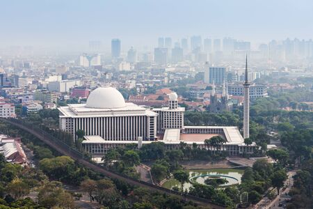 jakarta: JAKARTA, INDONESIA - OCTOBER 21, 2014: Aerial view of Istiqlal Mosque. It is the largest mosque in Southeast Asia.