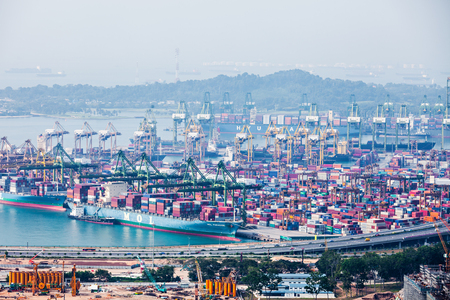 sea port: SINGAPORE - OCTOBER 18, 2014: The port of Singapore. Its the worlds busiest transshipment port and the worlds second busiest port in terms  of total shipping tonnage.