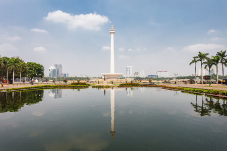 JAKARTA, INDONESIA - OCTOBER 21, 2014: The National Monument is a 132m tower in the centre of Merdeka Square, Jakarta, symbolizing the fight 
