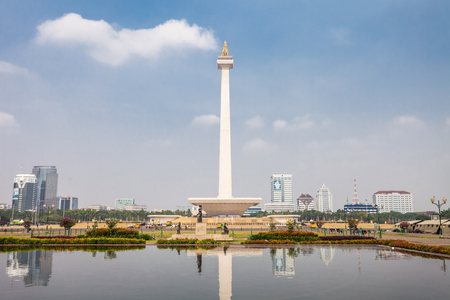 central square: JAKARTA, INDONESIA - OCTOBER 21, 2014: The National Monument is a 132m tower in the centre of Merdeka Square, Jakarta, symbolizing the fight  for Indonesia.