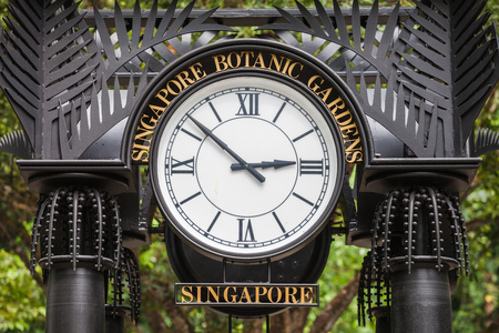 singapore: SINGAPORE - OCTOBER 17, 2014: Old Clock in The Singapore Botanic Gardens. Editorial