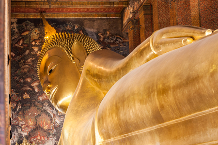 BANGKOK, THAILAND - NOVEMBER 09, 2014: Reclining Buddha figure in Wat Pho Buddhist temple complex in Bangkok, Thailand.