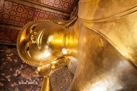 reincarnation: BANGKOK, THAILAND - NOVEMBER 09, 2014: Reclining Buddha figure in Wat Pho Buddhist temple complex in Bangkok, Thailand.