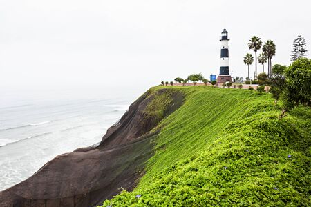miraflores district: La Marina Lighthouse (Faro la Marina) is a lighthouse in parkland on high cliffs above the Pacific Ocean, Miraflores district of Lima, Peru Stock Photo