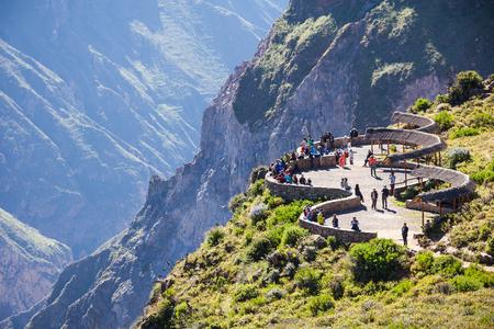 condor: Tourists at the Cruz Del Condor viewpoint, Colca canyon, Peru