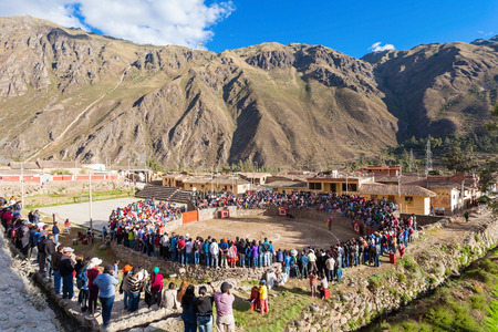 corrida: OLLANTAYTAMBO, PERU - MAY 24, 2015: Unidentified people are looking for corrida in Ollantaytambo, Peru.