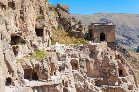rustaveli: Vardzia is a cave monastery site excavated from Erusheti Mountain on the left bank of the Mtkvari River, near Akhaltsikhe, Georgia.