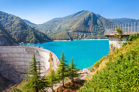 hill station tree: The Inguri Dam is a hydroelectric dam on the Inguri River in Georgia Stock Photo