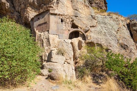geghard: Cave near Geghard Monastery in the Kotayk province of Armenia, carved out of the adjacent mountain.