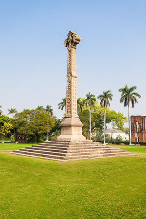 residency: High cross Sir Henry Lawrence Memorial at the British Residency complex in Lucknow, India Stock Photo