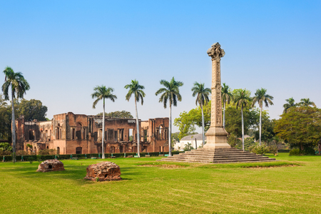 residency: Museum and the High cross Sir Henry Lawrence Memorial at the British Residency in Lucknow, India