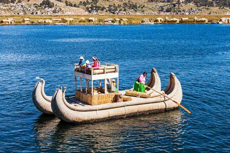 quechua: PUNO, PERU - MAY 14, 2015: Totora boat on the Titicaca lake near Puno, Peru Editorial