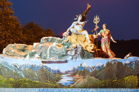 parvati: RISHIKESH, INDIA - NOVEMBER 08, 2015: A statuee of the Hindu god Shiva and his wife Parvati in Rishikesh at night, North India.