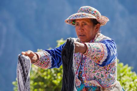 condor: CABANACONDE, PERU - MAY 13, 2015: Unidentified women selling souvenirs at Cruz Del Condor viewpoint.