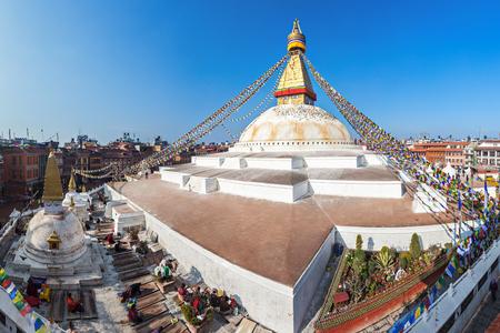 Unidentified pilgrims at the Boudhanath stupa in Kathmandu, Nepal Stock Photo